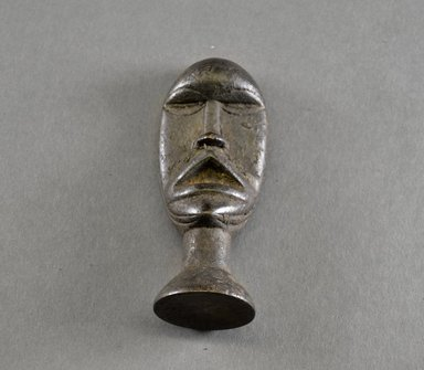 Loma. <em>Personal Miniature Mask</em>, 20th century. Wood, 4 5/8 x 1 3/4 x 1 1/2 in. (11.7 x 4.4 x 3.8 cm). Brooklyn Museum, Gift of Blake Robinson, 1995.7.24. Creative Commons-BY (Photo: Brooklyn Museum, 1995.7.24_front_PS5.jpg)