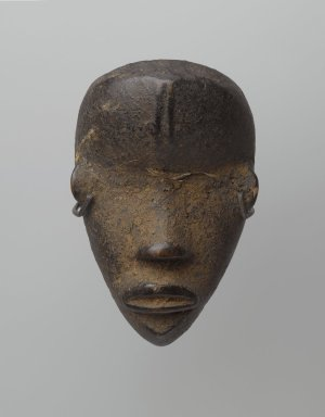 Dan. <em>Personal Miniature Mask (Ma Go)</em>, 19th or 20th century. Wood, organic matter, fiber or feathers, 4 3/4 x 3 x 2in. (12.1 x 7.6 x 5.1cm). Brooklyn Museum, Gift of Blake Robinson, 1995.7.28. Creative Commons-BY (Photo: Brooklyn Museum, 1995.7.28_front_PS6.jpg)