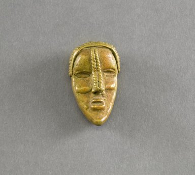 Dan. <em>Personal Miniature Mask</em>, 20th century. Brass, 2 1/2 x 1 3/8 x 3/4in. (6.4 x 3.5 x 1.9cm). Brooklyn Museum, Gift of Blake Robinson, 1995.7.29. Creative Commons-BY (Photo: Brooklyn Museum, 1995.7.29_front_PS5.jpg)