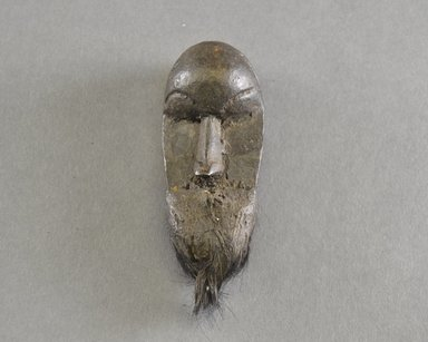 Kpelle. <em>Personal Miniature Mask</em>, 20th century. Wood, fur, clay?, 4 5/8 x 1 3/4 in. (11.7 x 4.4 cm). Brooklyn Museum, Gift of Blake Robinson, 1995.7.2. Creative Commons-BY (Photo: Brooklyn Museum, 1995.7.2_front_PS5.jpg)