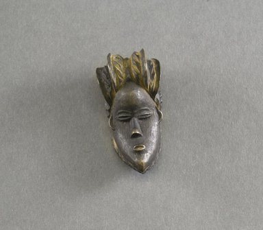 Bassa. <em>Personal Miniature Mask</em>, 20th century. Wood, 2 3/4 x 1 1/4 x 1in. (7 x 3.2 x 2.5cm). Brooklyn Museum, Gift of Blake Robinson, 1995.7.31. Creative Commons-BY (Photo: Brooklyn Museum, 1995.7.31_front_PS5.jpg)