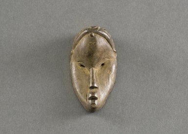 Dan. <em>Personal Miniature Mask</em>, 20th century. Wood, 2 7/8 x 1 1/2 x 1 1/8in. (7.3 x 3.8 x 2.9cm). Brooklyn Museum, Gift of Blake Robinson, 1995.7.33. Creative Commons-BY (Photo: Brooklyn Museum, 1995.7.33_front_PS5.jpg)