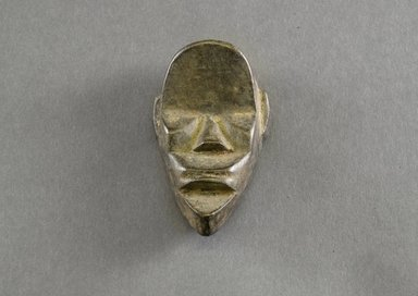 Mano. <em>Personal Miniature Mask</em>, 20th century. Wood, 3 3/8 x 2 x 3/4in. (8.6 x 5.1 x 1.9cm). Brooklyn Museum, Gift of Blake Robinson, 1995.7.34. Creative Commons-BY (Photo: Brooklyn Museum, 1995.7.34_front_PS5.jpg)