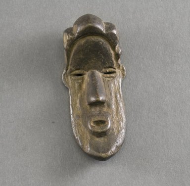 Bassa. <em>Personal Miniature Mask</em>, 20th century. Wood, 3 3/4 x 1 1/2 x 3/4in. (9.5 x 3.8 x 1.9cm). Brooklyn Museum, Gift of Blake Robinson, 1995.7.35. Creative Commons-BY (Photo: Brooklyn Museum, 1995.7.35_front_PS5.jpg)