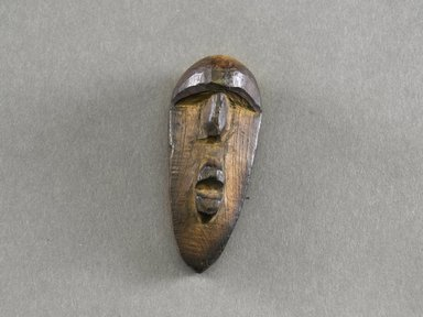 Kpelle. <em>Personal Miniature Mask</em>, 20th century. Wood, 2 7/8 x 1 1/4 x 1 1/8in. (7.3 x 3.2 x 2.9cm). Brooklyn Museum, Gift of Blake Robinson, 1995.7.36. Creative Commons-BY (Photo: Brooklyn Museum, 1995.7.36_front_PS5.jpg)