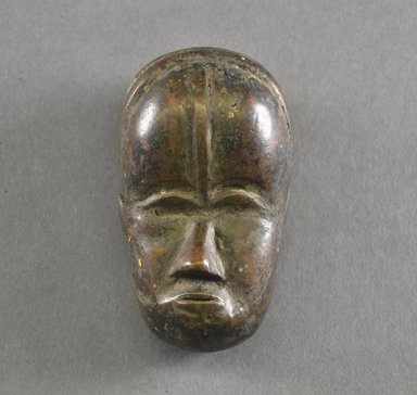 Mano. <em>Personal Miniature Mask</em>, 20th century. Wood, 4 x 2 1/2 x 2in. (10.2 x 6.4 x 5.1cm). Brooklyn Museum, Gift of Blake Robinson, 1995.7.37. Creative Commons-BY (Photo: Brooklyn Museum, 1995.7.37_front_PS5.jpg)