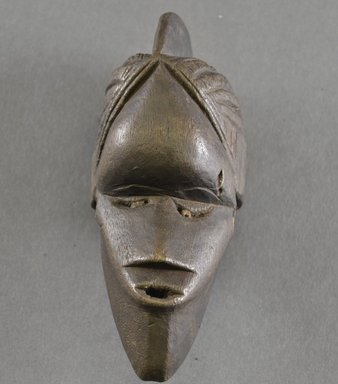 Bassa. <em>Personal Miniature Mask</em>, 20th century. Wood, 6 x 2 1/4 x 2 1/2 in. (15.2 x 5.7 x 6.4 cm). Brooklyn Museum, Gift of Blake Robinson, 1995.7.38. Creative Commons-BY (Photo: Brooklyn Museum, 1995.7.38_front_PS5.jpg)