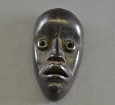 Dan. <em>Personal Miniature Mask</em>, 20th century. Wood, 5 1/8 x 2 7/8 x 2in. (13 x 7.3 x 5.1cm). Brooklyn Museum, Gift of Blake Robinson, 1995.7.39. Creative Commons-BY (Photo: Brooklyn Museum, 1995.7.39_front_PS5.jpg)