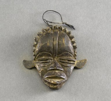 Dan. <em>Personal Miniature Mask</em>, 20th century. Wood, string, 3 x 3 1/8in. (7.6 x 7.9cm). Brooklyn Museum, Gift of Blake Robinson, 1995.7.3. Creative Commons-BY (Photo: Brooklyn Museum, 1995.7.3_front_PS5.jpg)