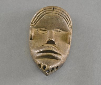 Mano. <em>Personal Miniature Mask</em>, 20th century. Wood, 5 x 2 3/4 x 1 1/2in. (12.7 x 7 x 3.8cm). Brooklyn Museum, Gift of Blake Robinson, 1995.7.40. Creative Commons-BY (Photo: Brooklyn Museum, 1995.7.40_front_PS5.jpg)