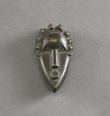 Bassa. <em>Personal Miniature Mask</em>, 20th century. Wood, 3 1/4 x 1 5/8 x 1in. (8.3 x 4.1 x 2.5cm). Brooklyn Museum, Gift of Blake Robinson, 1995.7.41. Creative Commons-BY (Photo: Brooklyn Museum, 1995.7.41_front_PS5.jpg)