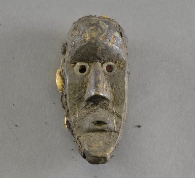 Bassa. <em>Personal Miniature Mask</em>, 20th century. Wood, 3 3/4 x 1/2 x 5/8in. (9.5 x 1.3 x 1.6cm). Brooklyn Museum, Gift of Blake Robinson, 1995.7.42. Creative Commons-BY (Photo: Brooklyn Museum, 1995.7.42_front_PS5.jpg)