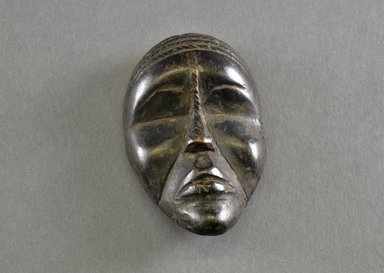 Mano. <em>Personal Miniature Mask</em>, 20th century. Wood, 4 1/8 x 2 1/2 x 1in. (10.5 x 6.4 x 2.5cm). Brooklyn Museum, Gift of Blake Robinson, 1995.7.43. Creative Commons-BY (Photo: Brooklyn Museum, 1995.7.43_front_PS5.jpg)