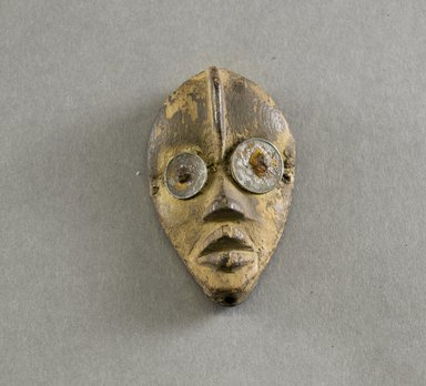 Dan. <em>Personal Miniature Mask</em>, 20th century. Wood, metal, 3 1/4 x 2in. (8.3 x 5.1cm). Brooklyn Museum, Gift of Blake Robinson, 1995.7.4. Creative Commons-BY (Photo: Brooklyn Museum, 1995.7.4_front_PS5.jpg)