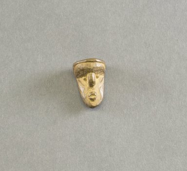 Bassa. <em>Personal Miniature Mask</em>, 20th century. Wood, 1 1/8 x 3/4 x 5/8 in. (2.9 x 1.9 x 1.6 cm). Brooklyn Museum, Gift of Blake Robinson, 1995.7.50. Creative Commons-BY (Photo: Brooklyn Museum, 1995.7.50_front_PS5.jpg)