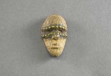 Dan. <em>Personal Miniature Mask</em>, 20th century. Wood, brass, 3 x 1 3/4 x 3/4in. (7.6 x 4.4 x 1.9cm). Brooklyn Museum, Gift of Blake Robinson, 1995.7.53. Creative Commons-BY (Photo: Brooklyn Museum, 1995.7.53_front_PS5.jpg)