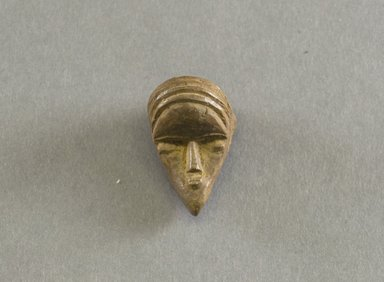 Bassa. <em>Personal Miniature Mask</em>, 20th century. Wood, 1 5/8 x 7/8 x 1 1/8in. (4.1 x 2.2 x 2.9cm). Brooklyn Museum, Gift of Blake Robinson, 1995.7.54. Creative Commons-BY (Photo: Brooklyn Museum, 1995.7.54_front_PS5.jpg)