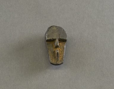 Kpelle ?. <em>Personal Miniature Mask</em>, 20th century. Wood, 1 7/8 x 1 x 3/4in. (4.8 x 2.5 x 1.9cm). Brooklyn Museum, Gift of Blake Robinson, 1995.7.57. Creative Commons-BY (Photo: Brooklyn Museum, 1995.7.57_front_PS5.jpg)