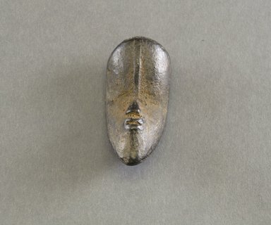 Bassa. <em>Personal Miniature Mask</em>, 20th century. Wood, 3 x 1 1/4 x 1 1/4 in. (7.6 x 3.2 x 3.2 cm). Brooklyn Museum, Gift of Blake Robinson, 1995.7.58. Creative Commons-BY (Photo: Brooklyn Museum, 1995.7.58_front_PS5.jpg)