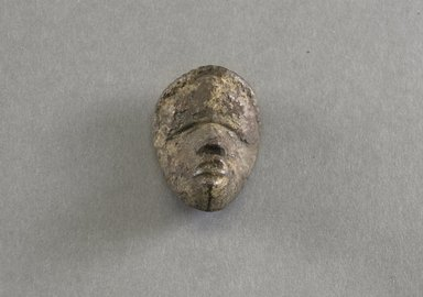 Dan. <em>Personal Miniature Mask</em>, 20th century. Wood, 2 1/4 x 1 5/8 x 3/4in. (5.7 x 4.1 x 1.9cm). Brooklyn Museum, Gift of Blake Robinson, 1995.7.61. Creative Commons-BY (Photo: Brooklyn Museum, 1995.7.61_front_PS5.jpg)