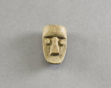 Dan. <em>Personal Miniature Mask</em>, 20th century. Wood, 2 1/4 x 1 1/4 x 1in. (5.7 x 3.2 x 2.5cm). Brooklyn Museum, Gift of Blake Robinson, 1995.7.64. Creative Commons-BY (Photo: Brooklyn Museum, 1995.7.64_front_PS5.jpg)