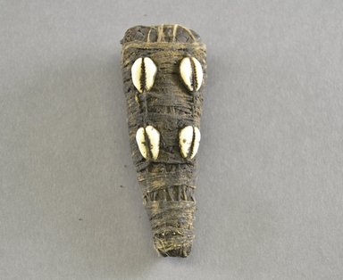 Dan. <em>Personal Miniature Mask</em>, 20th century. Wood, fiber, shell, organic matter, 4 1/2 x 1 5/8 x 1 3/8in. (11.4 x 4.1 x 3.5cm). Brooklyn Museum, Gift of Blake Robinson, 1995.7.66. Creative Commons-BY (Photo: Brooklyn Museum, 1995.7.66_front_PS5.jpg)