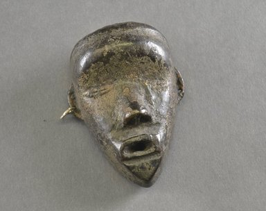 Mano. <em>Personal Miniature Mask</em>, 20th century. Wood, metal, 4 x 2 3/4 x 1 1/4in. (10.2 x 7 x 3.2cm). Brooklyn Museum, Gift of Blake Robinson, 1995.7.67. Creative Commons-BY (Photo: Brooklyn Museum, 1995.7.67_front_PS5.jpg)