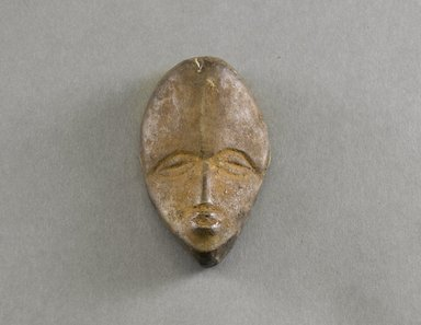 Dan. <em>Personal Miniature Mask</em>, 20th century. Wood, 3 3/4 x 2 1/4 x 1in. (9.5 x 5.7 x 2.5cm). Brooklyn Museum, Gift of Blake Robinson, 1995.7.68. Creative Commons-BY (Photo: Brooklyn Museum, 1995.7.68_front_PS5.jpg)