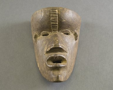 Gbi. <em>Personal Miniature Mask</em>, 20th century. Wood, 5 1/2 x 3 5/8 x 2 1/2 in. (14 x 9.2 x 6.4 cm). Brooklyn Museum, Gift of Blake Robinson, 1995.7.70. Creative Commons-BY (Photo: Brooklyn Museum, 1995.7.70_front_PS5.jpg)