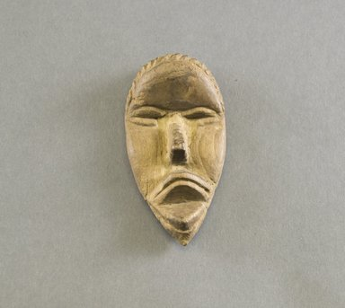 Dan. <em>Personal Miniature Mask</em>, 20th century. Wood, 4 1/8 x 2 1/8 x 7/8in. (10.5 x 5.4 x 2.2cm). Brooklyn Museum, Gift of Blake Robinson, 1995.7.73. Creative Commons-BY (Photo: Brooklyn Museum, 1995.7.73_front_PS5.jpg)
