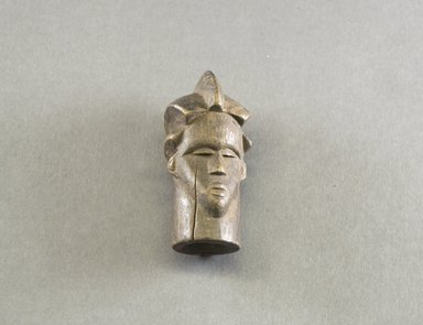 Bassa. <em>Personal Miniature Mask</em>, 20th century. Wood, 3 3/4 x 1 3/4 x 1 7/8 in. (9.5 x 4.4 x 4.8 cm). Brooklyn Museum, Gift of Blake Robinson, 1995.7.74. Creative Commons-BY (Photo: Brooklyn Museum, 1995.7.74_front_PS5.jpg)