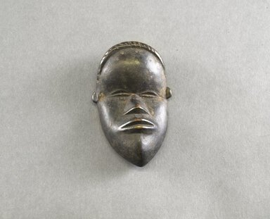 Mano. <em>Personal Miniature Mask</em>, 20th century. Wood, 3 7/8 x 2 3/8 x 1in. (9.8 x 6 x 2.5cm). Brooklyn Museum, Gift of Blake Robinson, 1995.7.75. Creative Commons-BY (Photo: Brooklyn Museum, 1995.7.75_front_PS5.jpg)