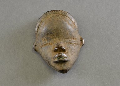 Dan. <em>Personal Miniature Mask</em>, 20th century. Wood, metal, 3 1/2 x 2 5/8 x 1 3/8in. (8.9 x 6.7 x 3.5cm). Brooklyn Museum, Gift of Blake Robinson, 1995.7.76. Creative Commons-BY (Photo: Brooklyn Museum, 1995.7.76_front_PS5.jpg)