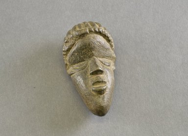 Bassa. <em>Personal Miniature Mask</em>, 20th century. Stone, 3 1/4 x 1 3/4 x 1 1/4 in. (8.3 x 4.4 x 3.2 cm). Brooklyn Museum, Gift of Blake Robinson, 1995.7.77. Creative Commons-BY (Photo: Brooklyn Museum, 1995.7.77_front_PS5.jpg)