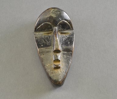 Kpelle. <em>Personal Miniature Mask</em>, 20th century. Wood, 4 1/4 x 2 1/8 x 1 3/4 in. (10.8 x 5.4 x 4.4 cm). Brooklyn Museum, Gift of Blake Robinson, 1995.7.79. Creative Commons-BY (Photo: Brooklyn Museum, 1995.7.79_front_PS5.jpg)