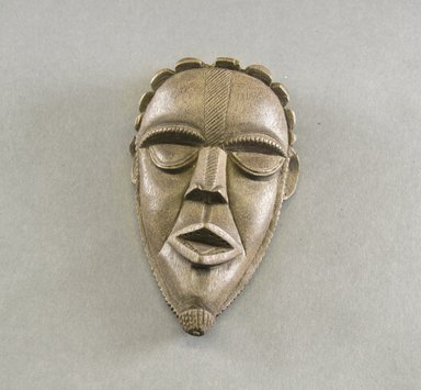 Bassa. <em>Personal Miniature Mask</em>, 20th century. Wood, 6 3/4 x 3 7/8 x 2in. (17.1 x 9.8 x 5.1cm). Brooklyn Museum, Gift of Blake Robinson, 1995.7.80. Creative Commons-BY (Photo: Brooklyn Museum, 1995.7.80_front_PS5.jpg)