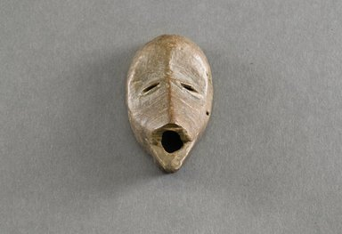 Dan. <em>Personal Miniature Mask</em>, 20th century. Wood, 3 1/8 x 1 5/8in. (7.9 x 4.1cm). Brooklyn Museum, Gift of Blake Robinson, 1995.7.9. Creative Commons-BY (Photo: Brooklyn Museum, 1995.7.9_front_PS5.jpg)