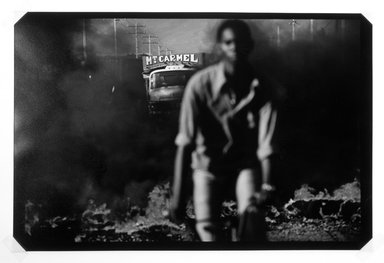 Alex Webb (American, born 1951). <em>Port au Prince, Haiti, 1987, Burning Barricades</em>, 1987. Cibachrome on Ilfochrome Classic paper Brooklyn Museum, Purchased with funds given by the Horace W. Goldsmith Foundation, Ardian Gill, the Coler Foundation, Harry Kahn, and Mrs. Carl L. Selden, 1995.75.1. © artist or artist's estate (Photo: Brooklyn Museum, 1995.75.1_bw.jpg)