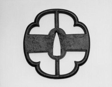 <em>Heianjo-Style Tsuba (Sword Guard)</em>, 17th century (possibly). Iron with gold and brass edging, height: 3 5/8 in. Brooklyn Museum, Gift of the J. Aron Charitable Foundation, Inc. in memory of Jack R. Aron, 1995.9.4. Creative Commons-BY (Photo: Brooklyn Museum, 1995.9.4_view1_bw.jpg)