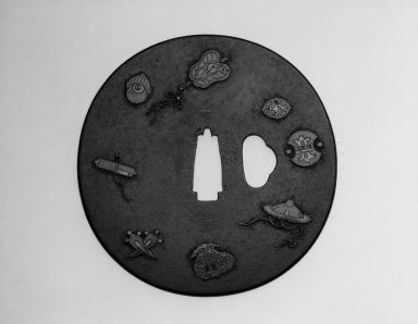 <em>Tsuba (Sword Guard) with Shippo (Seven Treasures) Design</em>, 18th century (possibly). Iron, copper, gold, enamels?, height: 3 1/2 in. Brooklyn Museum, Gift of the J. Aron Charitable Foundation, Inc. in memory of Jack R. Aron, 1995.9.5. Creative Commons-BY (Photo: Brooklyn Museum, 1995.9.5_view1_bw.jpg)