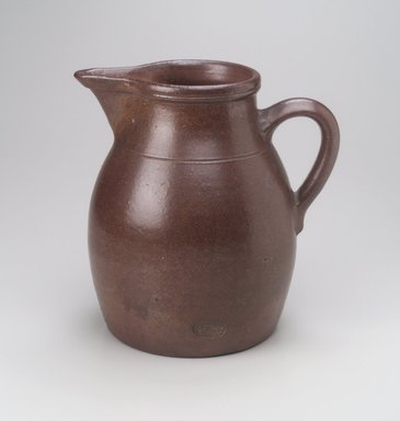 Charles Graham Chemical Pottery Works (1878-ca. 1913). <em>Pitcher</em>, late 19th century. Stoneware, 10 1/4 x 9 1/2 x 8 in. (26.0 x 24.1 x 20.4 cm). Brooklyn Museum, Gift of M. Christmann Zulli, 1996.10.1. Creative Commons-BY (Photo: Brooklyn Museum, 1996.10.1.jpg)
