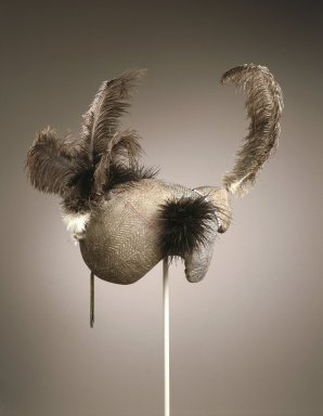 Dongiro. <em>Mudpack Coiffure</em>, 20th century. Organic material, pigment, human hair, plastic beads, ostrich feathers, copper alloy, aluminum, 13 3/4 x 12 1/2 x 15 in. (35.0 x 31.8 x 38.2 cm). Brooklyn Museum, John W. James Fund, 1996.112.1. Creative Commons-BY (Photo: Brooklyn Museum, 1996.112.1_SL1.jpg)
