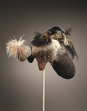 Karamojong. <em>Mudpack Coiffure (Emedot)</em>, 20th century. Organic material, pigment, human hair, plastic beads, ostrich feathers, chicken feathers, 12 1/2 x 12 1/2 x 19 3/4 in. (31.8 x 31.8 x 50.1 cm). Brooklyn Museum, John W. James Fund, 1996.112.2. Creative Commons-BY (Photo: Brooklyn Museum, 1996.112.2_SL1.jpg)