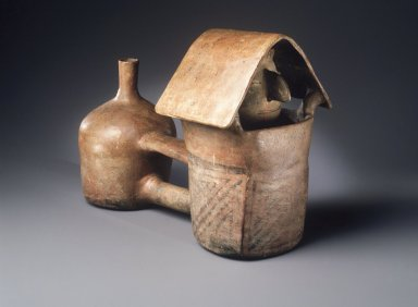 Vicus. <em>Double-Bodied Vessel with Figure within a House</em>, ca. 100-500. Ceramic, resist slip, 7 1/8 x 10 1/4 x 5 1/4 in. Brooklyn Museum, Bequest of Mrs. Carl L. Selden, 1996.116.16. Creative Commons-BY (Photo: Brooklyn Museum, 1996.116.16_transpc002.jpg)