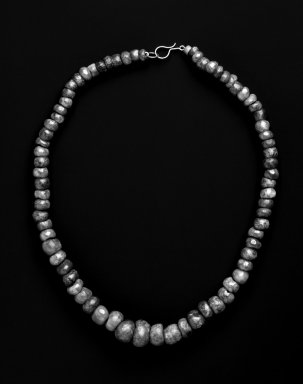 Maya. <em>Necklace</em>, 300-600. Jade beads (prehispanic), metal chain and clasp (modern), 3/8 × 3/8 × 16 in. (1 × 1 × 40.6 cm). Brooklyn Museum, Bequest of Mrs. Carl L. Selden, 1996.116.4. Creative Commons-BY (Photo: Brooklyn Museum, 1996.116.4_bw.jpg)
