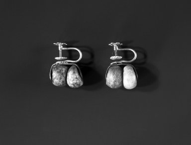 <em>Earrings</em>. Serpentine beads, silver earring backs, each bead: approximately 1/2 in. Brooklyn Museum, Bequest of Mrs. Carl L. Selden, 1996.116.9a-b. Creative Commons-BY (Photo: Brooklyn Museum, 1996.116.9a-b_bw.jpg)
