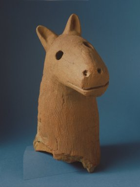 <em>Haniwa Head of a Dog</em>, 5th-6th century. Buff-red earthenware, 16 3/8 x 15 1/4 x 9 3/8 in. (including stand). Brooklyn Museum, Gift of Mrs. Carl L. Selden, 1996.123.1. Creative Commons-BY (Photo: Brooklyn Museum, 1996.123.1_SL1.jpg)