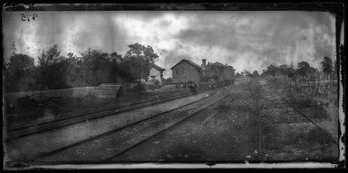 George Bradford Brainerd (American, 1845-1887). <em>Railroad Station at Port Jefferson, Long Island</em>, August 1878. Collodion silver glass wet plate negative Brooklyn Museum, Brooklyn Museum/Brooklyn Public Library, Brooklyn Collection, 1996.164.2-973 (Photo: Brooklyn Museum, 1996.164.2-973_glass_bw_SL1.jpg)