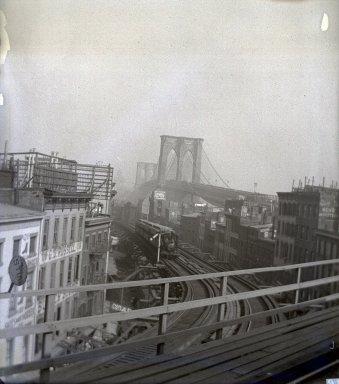 Edgar S. Thomson (American, active 1890s-1900s). <em>Brooklyn Bridge and Elevated Road to Fulton Ferry</em>, 1896. Glass plate negative, 4 x 5 in. (10.2 x 12.7 cm). Brooklyn Museum, Brooklyn Museum/Brooklyn Public Library, Brooklyn Collection, 1996.164.7-21 (Photo: Brooklyn Museum, 1996.164.7-21_glass_SL1.jpg)