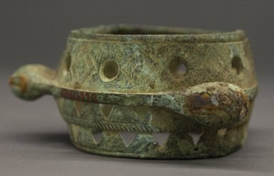 Akan. <em>Bracelet</em>, 19th century or earlier. Copper alloy, 2 1/2 x 5 in. (6.4 x 12.7 cm). Brooklyn Museum, Gift of Drs. John I. and Nicole Dintenfass, 1996.199.2. Creative Commons-BY (Photo: Brooklyn Museum, 1996.199.2_PS10.jpg)